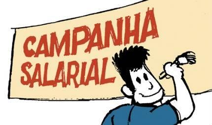 Charge: Trabalhador faz cartaz da Campanha Salarial (Laerte)