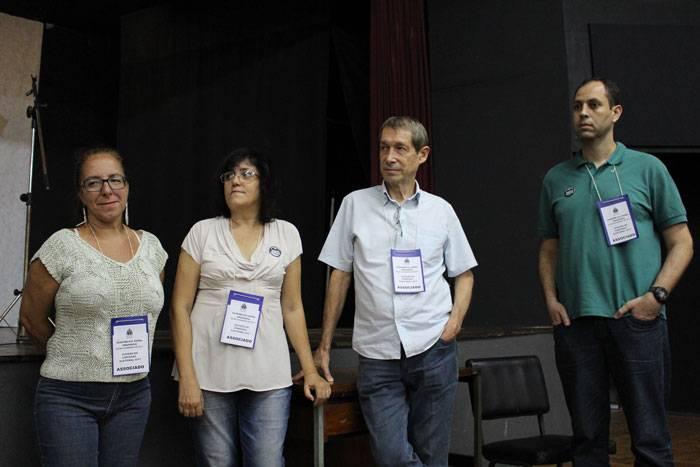 Foto dos quatro integrantes da Comissão Eleitoral